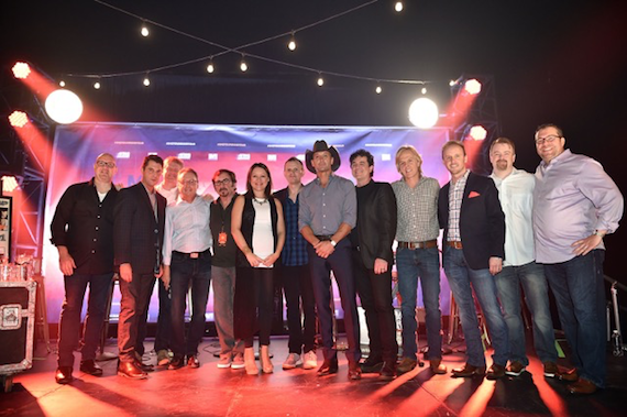 "Tim McGraw (center) celebrates ""Shotgun Rider"" with songwriters and industry members."
