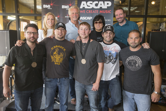 "Celebrating Jason Aldean's No. 1 hit ""Just Gettin' Started."" (L-R): (back row): BMI's Leslie Roberts, Combustion Music's Chris Farren, ASCAP's John Titta and Sony/ATV's Josh VanValkenburg. (Front row): songwriter Chris DeStefano, BMI affiliate Jason Aldean, songwriter Ashley Gorely, BMI songwriter Rhett Akins and producer Michael Knox."