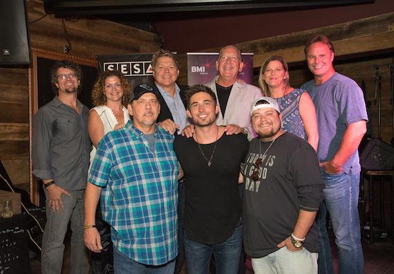 Pictured: (L-R): (Back Row) Parallel's Tim Hunze, Magic Mustang's Juli Newton-Griffith, BMI's David Preston, Warner Music Group's John Esposito, SESAC's Shannan Hatch, producer Scott Hendricks. (Front Row) BMI songwriter Michael White, BMI affiliate Michael Ray and songwriter Justin Wilson. (photo by Steve Lowry)