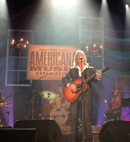 Host for the evening Jim Lauderdale performs during the 2015 Americana Music Awards.