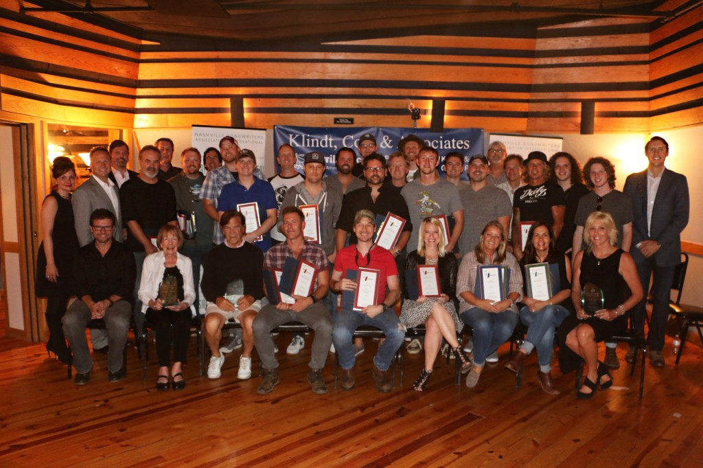 Songwriters with their No. 1 plaques.