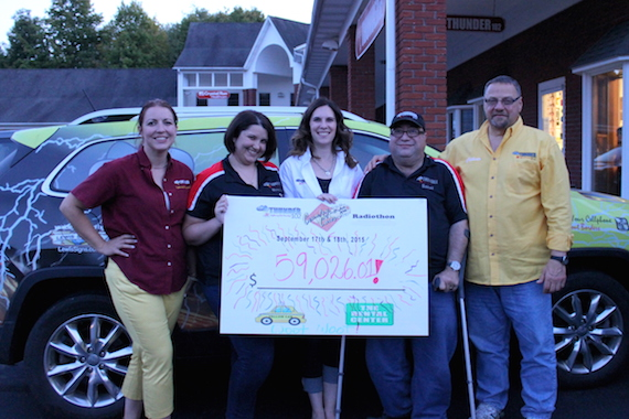 Thunder 102 staffers celebrate Country Cares for St. Jude Kids Radiothon.