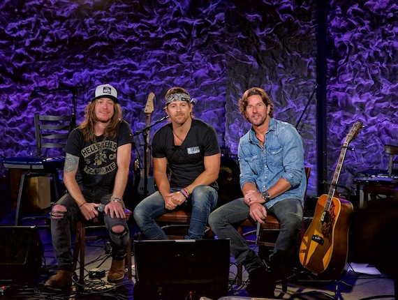 "l-r) Jaren Johnston, Kip Moore, and Brett James before a special taping of the CMA Songwriters Series for ""Front and Center"" at the Iridium Monday in New York. Photo Credit: Jim Belmont Photography"