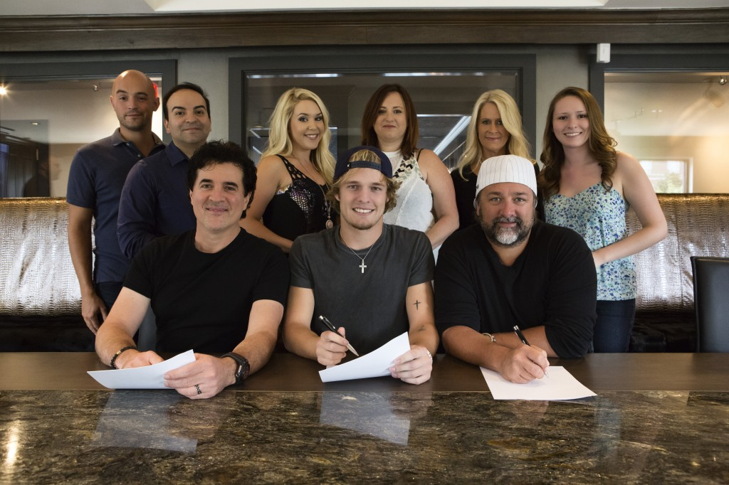 Pictured (L-R): Back Row – Big Machine Music's Alex Heddle, Mike Molinar, Tali Canterbury, Manager Mary Hilliard Harrington, Big Machine Label Group's Allison Jones and Big Machine Music's Brianna Steinitz Front Row – BMLG's Scott Borchetta, Tucker Beathard & Dot Records' Chris Stacey Photo Credit: Seth Hellman for Dot Records.