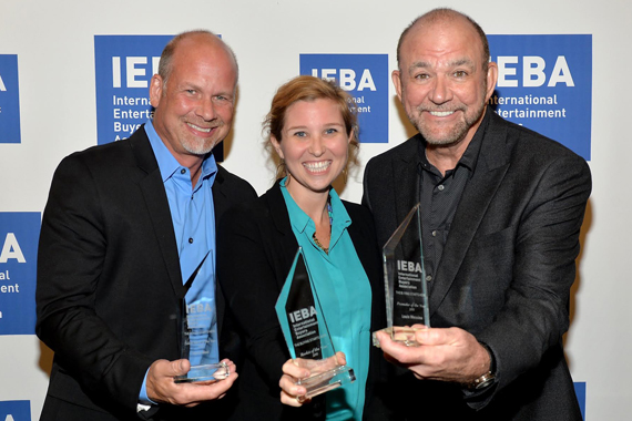 Pictured (L-R): WME's Kevin Neal, CAA's Kylen Sharpe, and Louis Messina of Messina Touring Group pose backstage with their awards during the Honors and Awards Ceremony at the IEBA 2015 Conference. Photo: Jason Davis/Getty Images