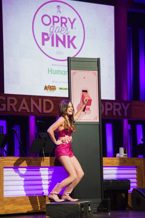 """Kacey Musgraves flips the switch on the Grand Ole Opry's signature barn turning it pink at the 7th Annual """"Opry Goes Pink"""" show."""