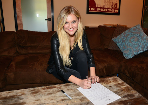Kelsea Ballerini signing up for Academy of Country Music membership.  Photo: Michel Bourquard/Courtesy of the Academy of Country Music
