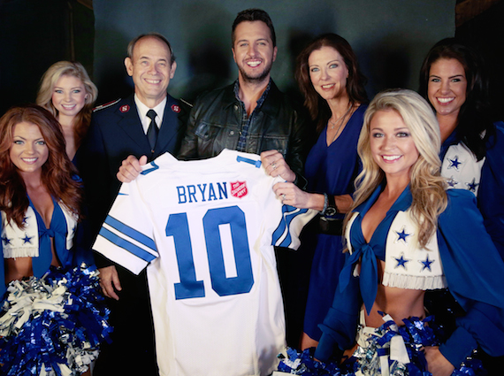 Pictured with Luke Bryan are Charlotte Jones Anderson, executive vice president and chief brand officer for the Dallas Cowboys and former national advisory chairperson for The Salvation Army, Lt. Col. Ron Busroe, and members of the Dallas Cowboys Cheerleaders.