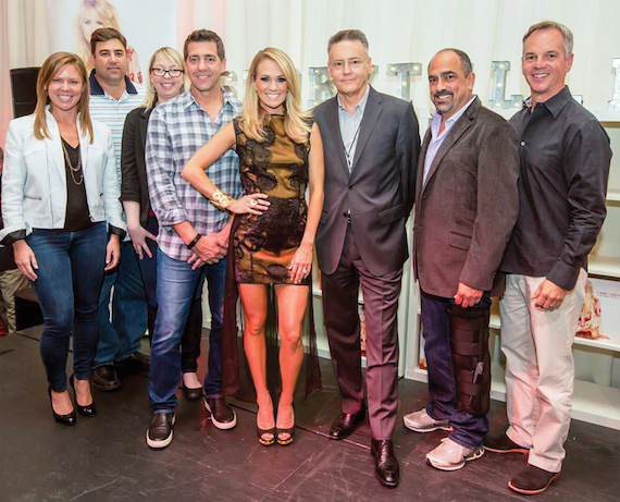 Pictured (L-R): Lesly Simon, VP, Promotion, Arista Nashville; Jim Catino, VP, A&R, Sony Music Nashville; Ann Edelblute, Carrie Underwood's manager (The HQ); Ken Robold, Executive VP/Chief Operating Officer; Carrie Underwood; Randy Goodman, Chairman & CEO, Sony Music Nashville; Paul Barnabee, Senior VP, Marketing, Sony Music Nashville; and, Steve Hodges, Executive VP, Promotion & Artist Development. Photo: Chris Hollo