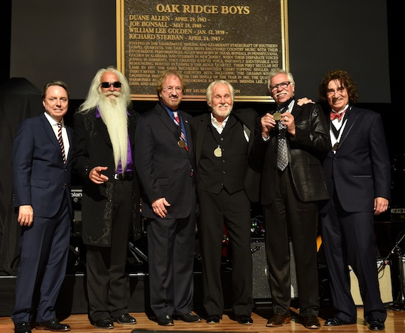 The Oak Ridge Boys are inducted into the Country Music Hall of Fame. Pictured (L-R): Jody Williams, William Lee Golden, Duane Allen, Kenny Rogers, Joe Bonsall, and Richard Sterban