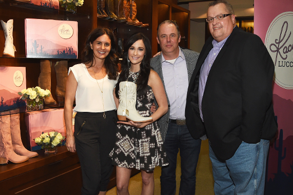 Pictured (L-R): Jennifer Huggins, Lucchese; Kacey Musgraves; and Lucchese's Doug Kindy and Randy Steele. Photo: Rick Diamond/Getty Images