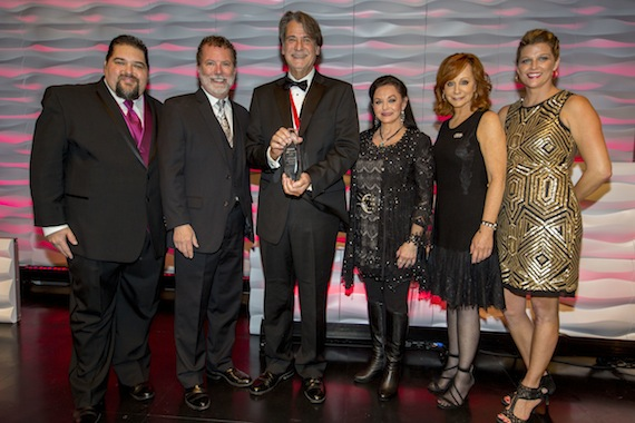 Pictured (L-R): SESAC's Tim Fink & Dennis Lord, Richard Leigh, Crystal Gayle, Reba McEntire and SESAC's Shannan Hatch. Photo: Ed Rode