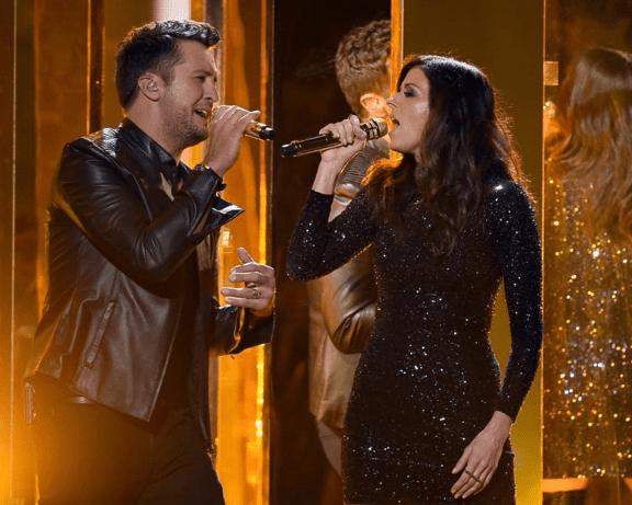 Luke Bryan and Karen Fairchild perform during the American Music Awards.