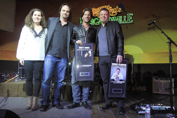 Pictured (L-R): MR's Sarah Skates and Sherod Robertson present Songwriter of the Year honors to Brett James and Rodney Clawson. Photo: Bev Moser/Moments By Moser