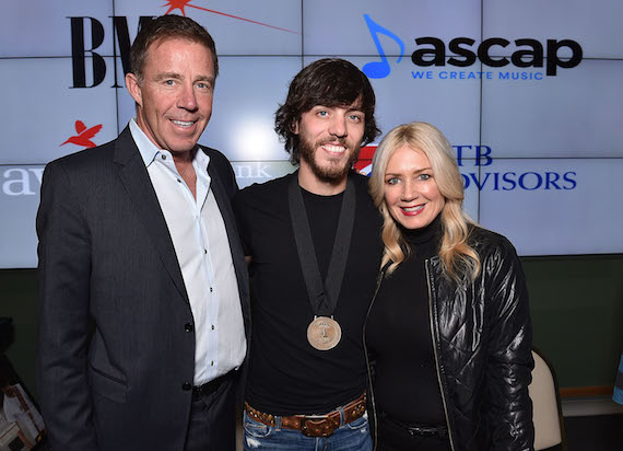 Pictured (L-R): TK Kimbrell (TKO Management), Chris Janson, and Kelly Janson. Photo: John Shearer/Getty Images for BMI.