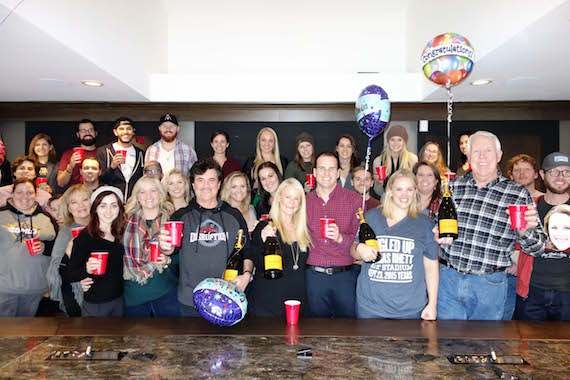 Pictured: Big Machine Label Group President/CEO Scott Borchetta (center left) leads celebrations with The Valory Music Co.'s SVP Promotion George Briner (far right), VMC promo staff and fellow BMLG staffers.