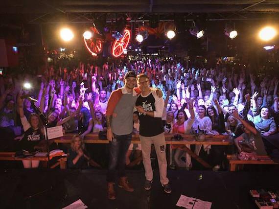 Kane Brown celebrates his new record deal on Sony Music Nashville with Sony Music Nashville Chairman & CEO Randy Goodman.