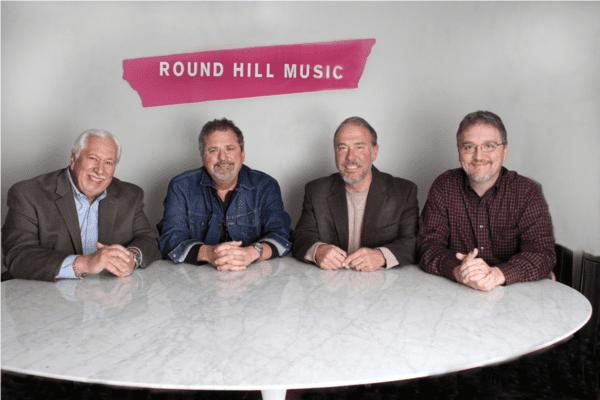 Pictured (L-R): Mike Milom, attorney; Bob DiPiero; Mark Brown, VP/GM, Round Hill Music Nashville; Matthew Beckett, attorney