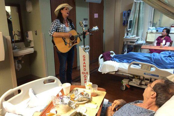Terri Clark performing for veterans