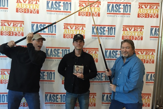 Granger Smith (center) goofs around with  at his hometown station in Austin -IHEART's KASE promoting his new release REMINGTON out on 3/4. VP of programming Travis Moon & MD Bob Pickett
