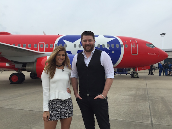Republic Nashville's Cassadee Pope and RCA Records' Chris Young in front of Southwest Airlines' Tennessee One.