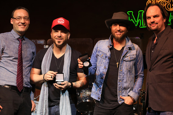 "LOCASH accepts No. 1 Challenge Coins for writing and performing the final No. 1 on the MusicRow CountryBreakout Chart of 2015, ""I Love This Life"" (Dec. 17, 2015)"