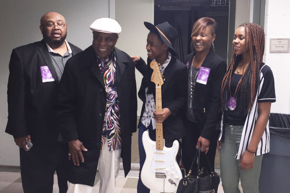 Buddy Guy with Sophia Gulley and recipients from local organization, YEAH.