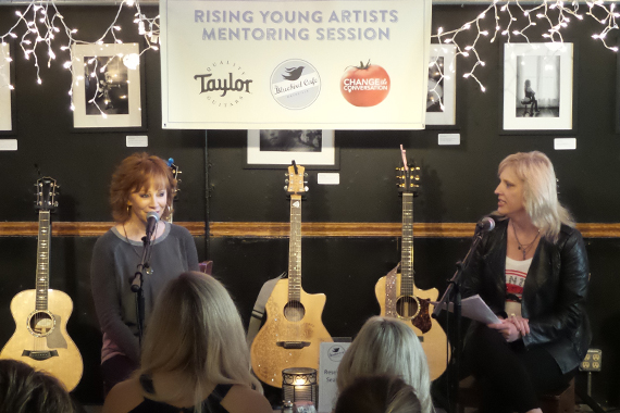 Reba (L) speaks at the March 29 Change The Conversation Mentoring Event with Beverly Keel (R).