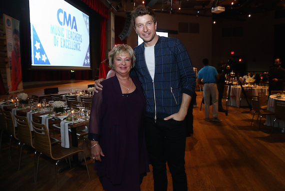 Brett Eldredge, host of the CMA Music Teacher of Excellence, welcomes his own childhood music teacher, Judy Carroll, as his special guest at the inaugural honors evening at City Winery Tuesday in Nashville. Photo: Kayla Schoen / CMA