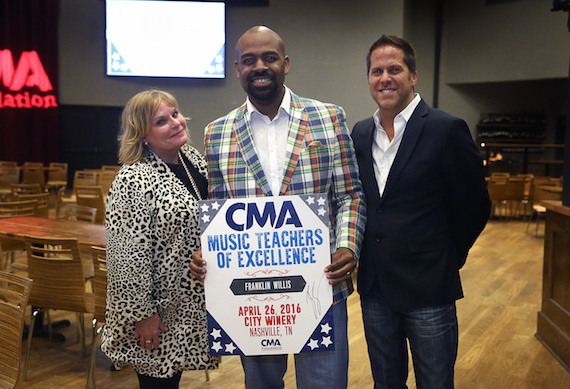 CMA Music Teacher of Excellence Franklin Willis, Choral Director at Madison Middle Prep (center), with Dr. Nola Jones, Coordinator of Visual and Performing Arts, Metro Nashville Public Schools, and Jon Loba, Executive Vice President, BBR Music Group and CMA Board member, at the CMA Music Teacher of Excellence honors at City Winery Tuesday in Nashville. Photo: Kayla Schoen / CMA