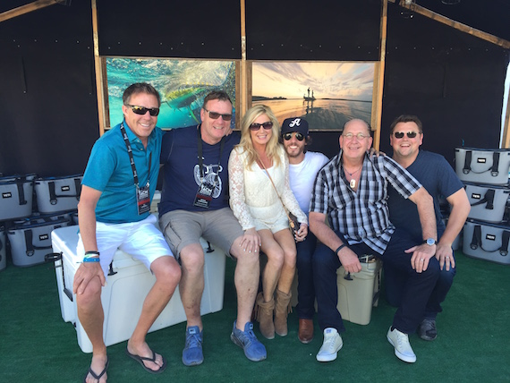 Chris Janson, winner of Country Song of the Year at the iHeartRadio Music Awards, posed for photos backstage at the ACM Party For a Cause Festival with TK Kimbrell (TKO Management), Peter Strickland (EVP & GM, WMN), Kelly Janson, John Esposito (President & CEO, WMN), and Storme Warren.