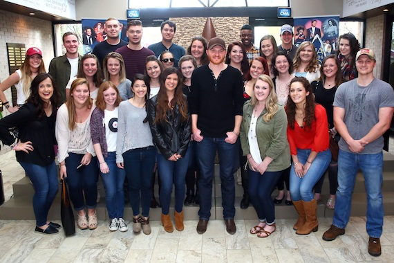 Eric Paslay (center) gathers with CMA EDU students from Belmont, Middle Tennessee State, and Vanderbilt Universities Thursday at the CMA office. Photo: Kayla Schoen / CMA