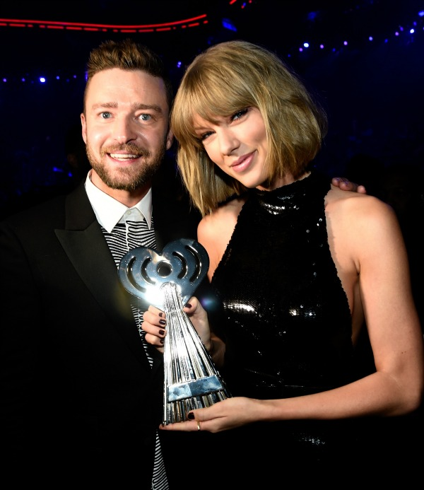 INGLEWOOD, CALIFORNIA - APRIL 03: Singer Taylor Swift (R), winner of the Best Tour award, and singer Justin Timberlake pose backstage at the iHeartRadio Music Awards which broadcasted live on TBS, TNT, AND TRUTV from The Forum on April 3, 2016 in Inglewood, California. (Photo by Kevin Mazur/Getty Images for iHeartRadio / Turner)