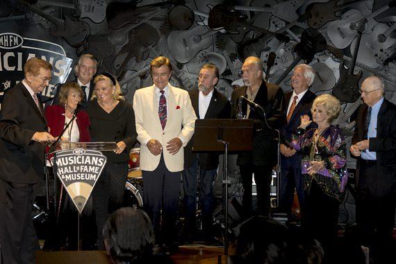 Pictured (L-R): Harold Bradley, Jo Walker-Meador, Mike Curb, LaRawn Scaife Rhea, Ray Walker, Ray Stevens, Joe Scaife, Bob Fisher, Charlie McCoy