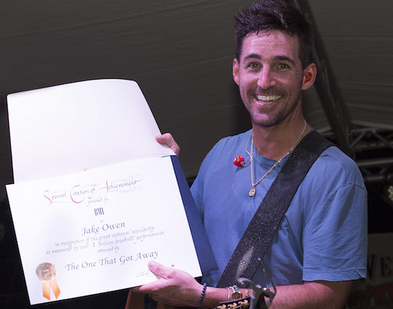 Jake Owen receives a Millionaire Award during his concert on the Duval Street stage during Key West Songwriters Festival on May 7, 2016. Photo: Erika Goldring