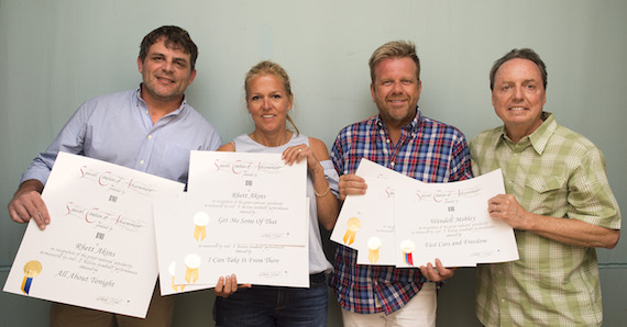 BMI's Leslie Roberts and Jody Williams present Rhett Akins and Wendell Mobley with Millionaire Awards at the San Carlos Institute during Key West Songwriters Festival on May 6, 2016. (Erika Goldring Photo)