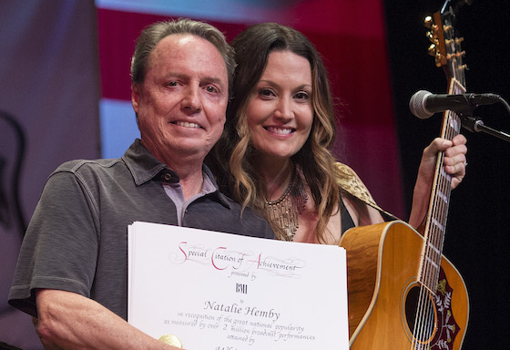 BMI's Jody Williams presents Natalie Hemby with a Millionaire Award at the San Carlos Institute during Key West Songwriters Festival on May 5, 2016. (Erika Goldring Photo)
