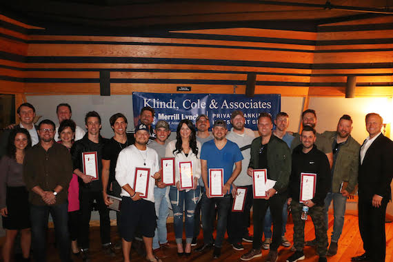 Songwriters with their No. 1 plaques. Photo: courtesy of NSAI