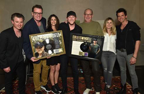 "Cole was able to celebrate this year with his radio promotion team at Warner Music Nashville for the three of the six No. 1 singles they helped take to the top of the charts (""Let Me See Ya Girl,"" Hope You Get Lonely Tonight,"" Ain't Worth The Whiskey"") (L to R): Chad Schultz (VP Radio Marketing & Promotion), Katie Bright (Director, National Promotion), writer/producer Michael Carter, Kristen Williams (VP Promotion), Cole Swindell, John Esposito (Chairman & CEO), Mallory Opheim (Regional Promotion Manager), Branden Bosler (Promotion Coordinator) // Photo credit: Steve Lowry"