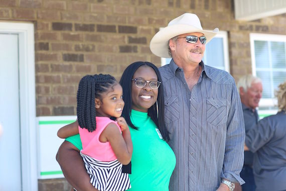 Alan Jackson with new Rutherford County Area Habitat homeowner Keosha Hendricks and her daughter Akori' Yahah after receiving keys to her new home