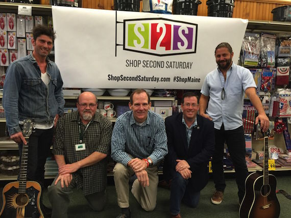 Pictured (Standing, L-R): BMI Songwriters Dave Pahanish, Hugh Mitchell Kneeling: Reny's Store Manager Carl Hodge, BMI's Dan Spears, Retail Association of Maine Executive Director Curtis Picard.