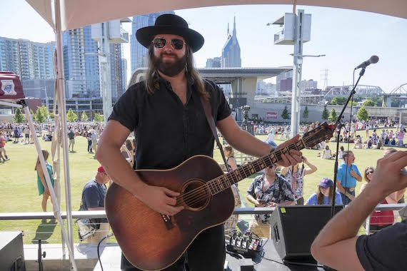 Pictured: CJ Solar on the ASCAP Budweiser Acoustic Stage at Ascend Amphitheater
