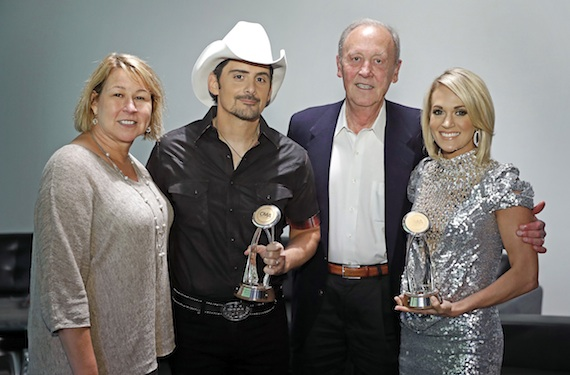 Pictured (L-R): Sarah Trahern, CMA Chief Executive Officer; Brad Paisley; Frank Bumstead, former CMA Board Chairman and Chairman of Flood, Bumstead, McCready & McCarthy, Inc.; Carrie Underwood. Photo: John Russell / CMA