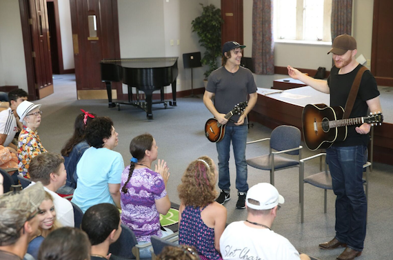 Ross Copperman (L) and Eric Paslay (R) work with campers to write a song. Photo: Getty Images
