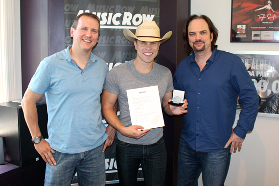 Pictured (L-R): Troy Stephenson, Chart Director, MusicRow; Dustin Lynch; Sherod Robertson, Owner/Publisher, MusicRow