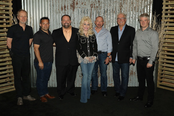 Pictured (L-R): Dean Roney, Lee Moro, Danny Nozell, Dolly Parton, Paul Owen, Richard Lachance, Martin Chouinard