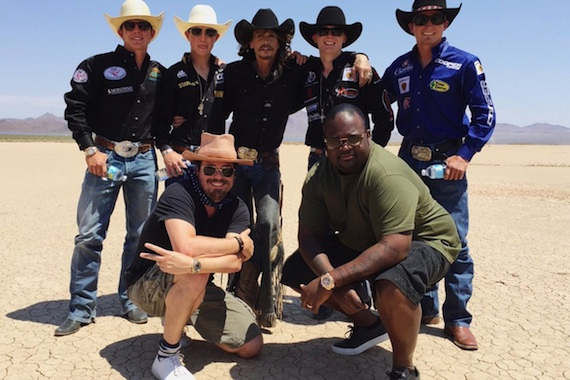 Steven Tyler (Center, back row) poses with members of Professional Bull Riders (PBR)