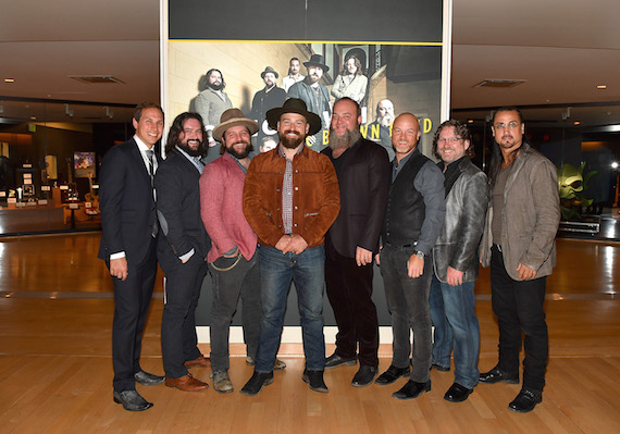 "Pictured (L-R): Musical artist Jimmy De Martini, songwriter Clay Cook, music arranger Coy Bowles, singer Zac Brown, musician John Driskell Hopkins, musical artist Matt Mangano, drummer Chris Fryar and percussionist Daniel de los Reyes from musical group Zac Brown Band attend The Country Music Hall of Fame and Museum Debuts ""Homegrown: Zac Brown Band"" Exhibit at Country Music Hall of Fame and Museum on July 19, 2016 in Nashville, Tennessee. Photo: Jason Davis/Getty Images for Country Music Hall Of Fame & Museum"