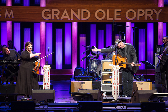"""Vince Gill celebrates and pays mutual respect to friend Andrea Zonn who joined him onstage for one of his classic hits """"Look At Us"""""""