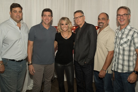 (Pictured L-R): Jim Catino, A&R VP; Ken Robold, EVP & COO; Carrie Underwood; Randy Goodman, Chairman & CEO; Paul Barnabee, Marketing Sr. VP; Steve Hodges, EVP Promotion & Artist Development. Photo credit: Jeff Johnson